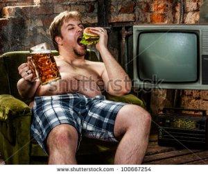 stock-photo-fat-man-eating-hamburger-seated-on-armchair-100667254